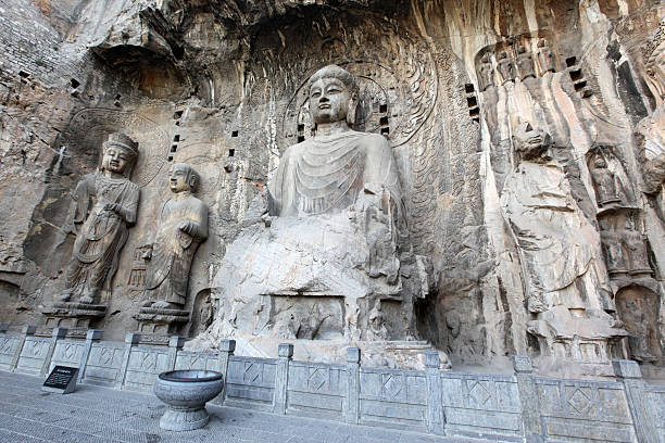 Luoyang The Buddha of Longmen Grottoes Luoyang The Buddha of Longmen Grottoes in China bodhisattva stock pictures, royalty-free photos & images