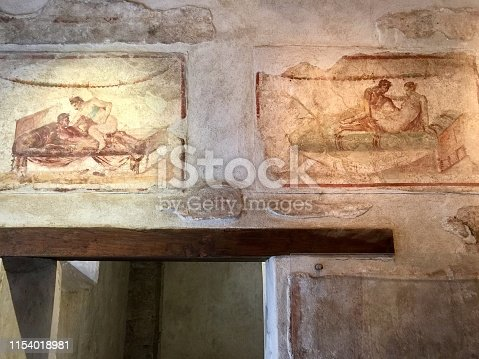 Erotic wall frescoes in a brothel in the ancient Roman city of Pompeii
