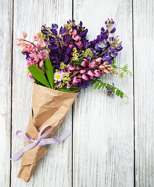 lupine flowers on a  table - bouquet stock photos and pictures