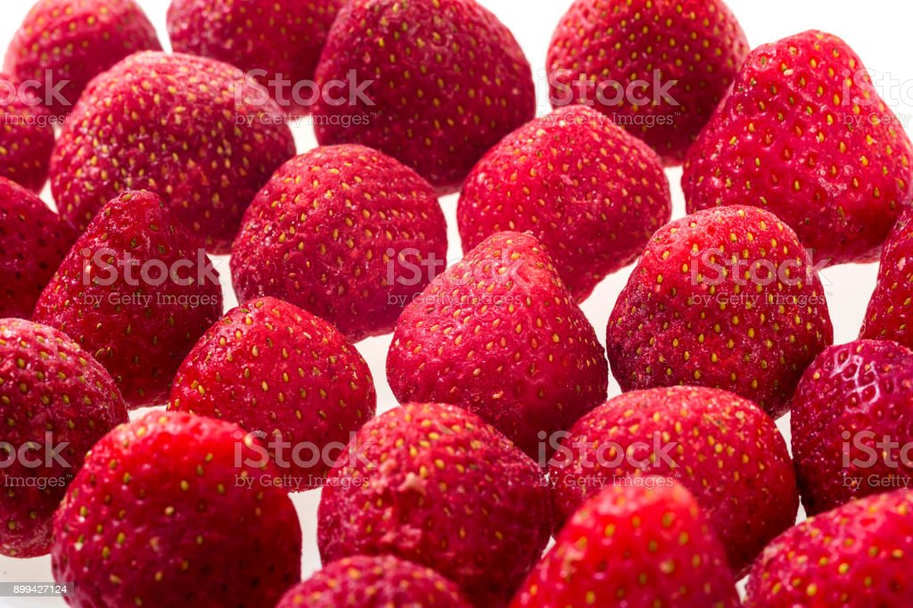 luscious frozen strawberries isolated on white background, delicious first class organic fruit as a concept of summer vitamins stock photo
