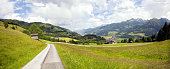 Beautiful lush green Austrian alp valley meadows landscape and hiking trails in the Zell am See area.