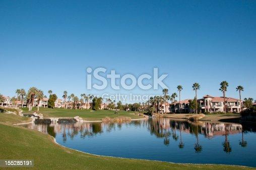 A lush green golf course winds through a residential development near Palm Springs, California.