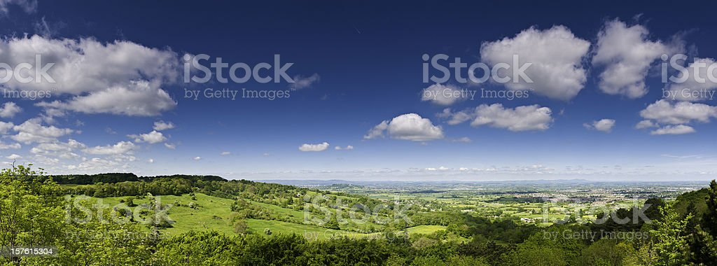 Lush green landscape summer country panorama farms fields big sky royalty-free stock photo