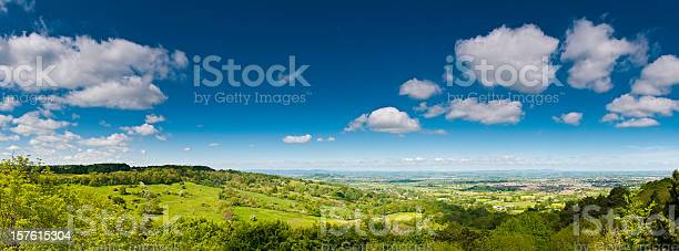 Photo of Lush green landscape summer country panorama farms fields big sky