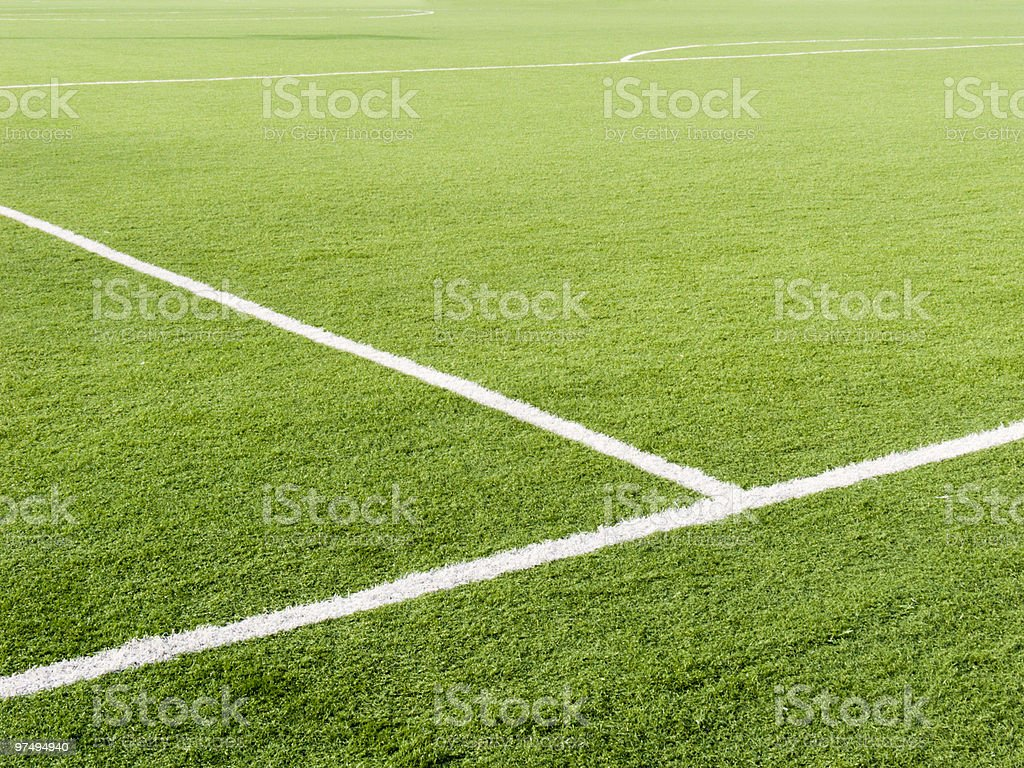 Lush green soccer field with white lines royalty-free stock photo