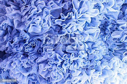 istock Lush her skirt. Blue background flounces 486644758