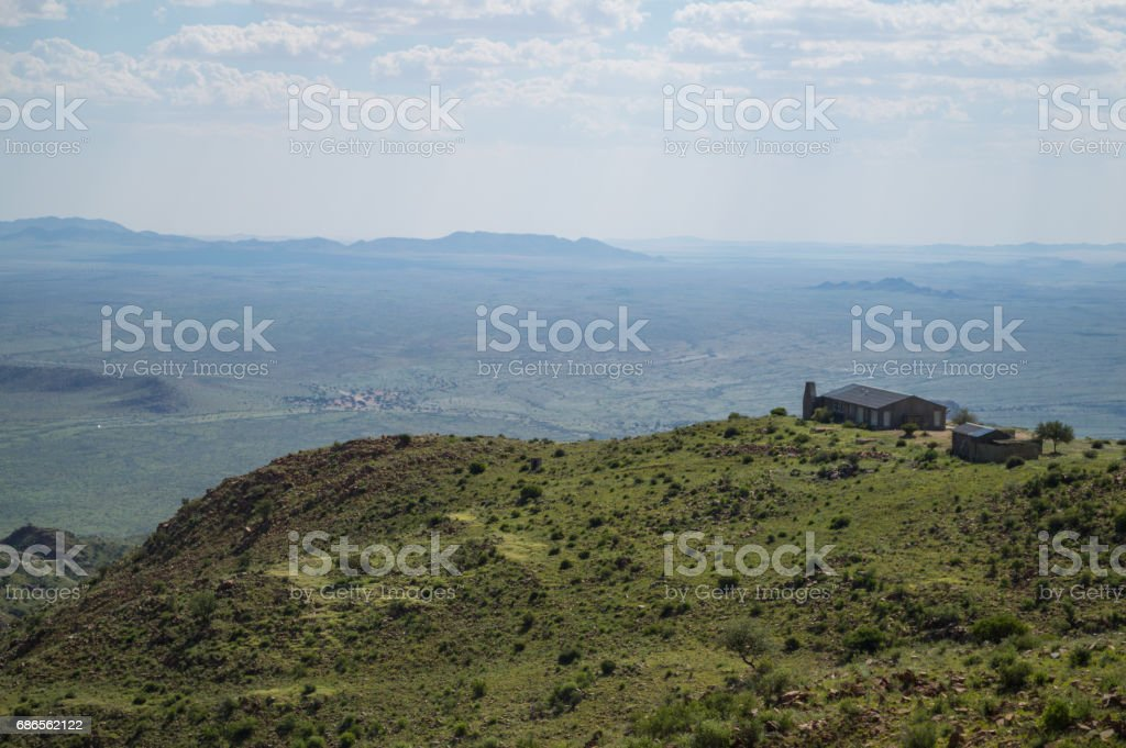 Lush Mountain Landscape with Road and House with a View in Namibia royalty-free stock photo