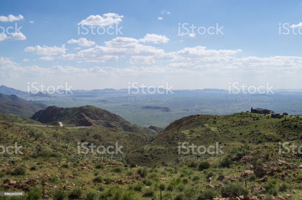 Lush Mountain Landscape with Road and House with a View in Namibia zbiór zdjęć royalty-free
