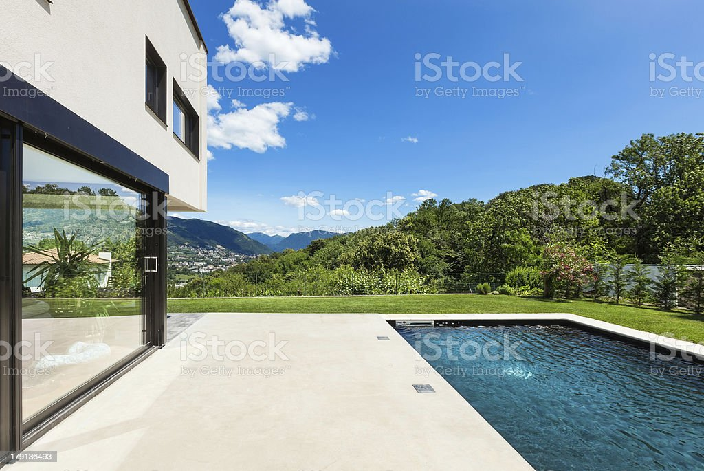 Lush, mountain side view from modern villa with a pool stock photo