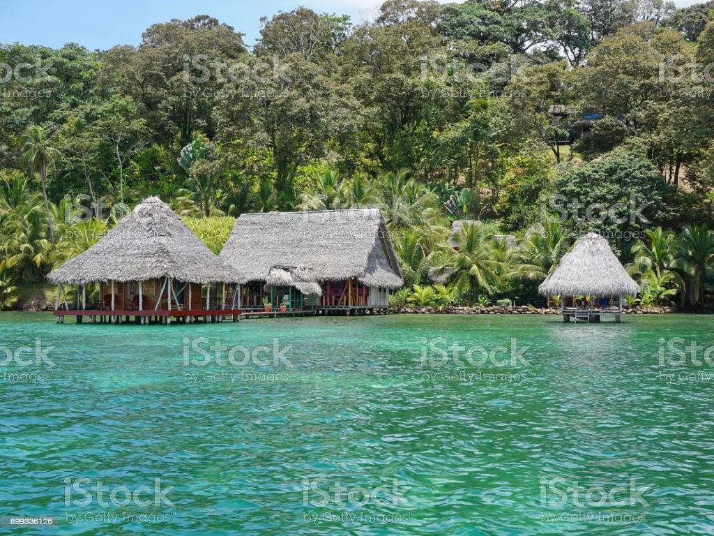 Lush tropical shore with eco resort over the sea stock photo