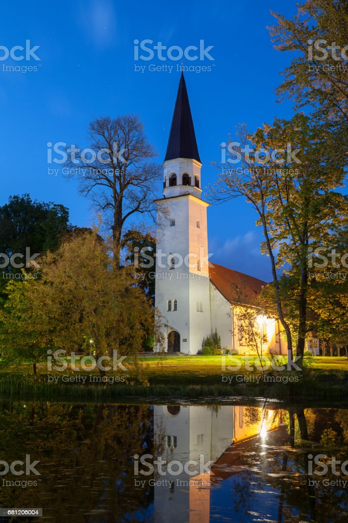 Lutheran stone white church with reflection in the pond. Sigulda, Latvia. royalty-free stock photo