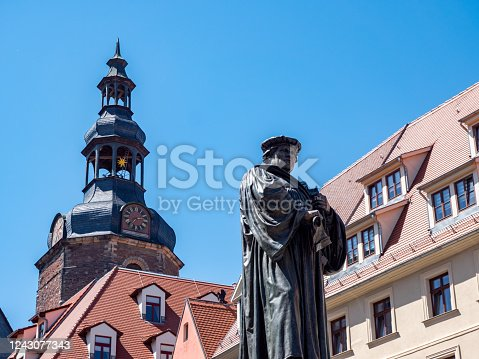istock Lutherstadt Eisleben statue of Luther in the market 1243077343