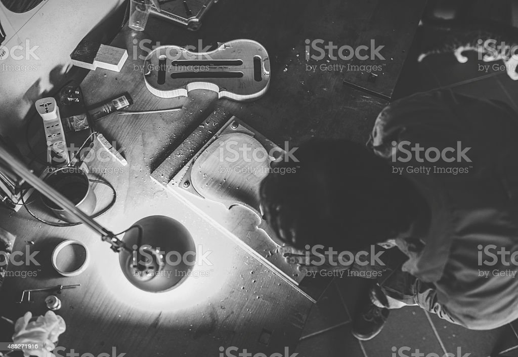Luthier making a violin stock photo