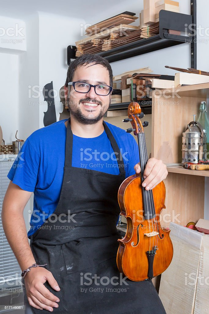 luthier with a violin stock photo