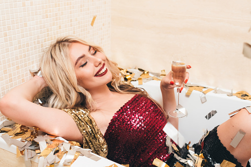 luxe party relaxing blonde lady bathtub confetti