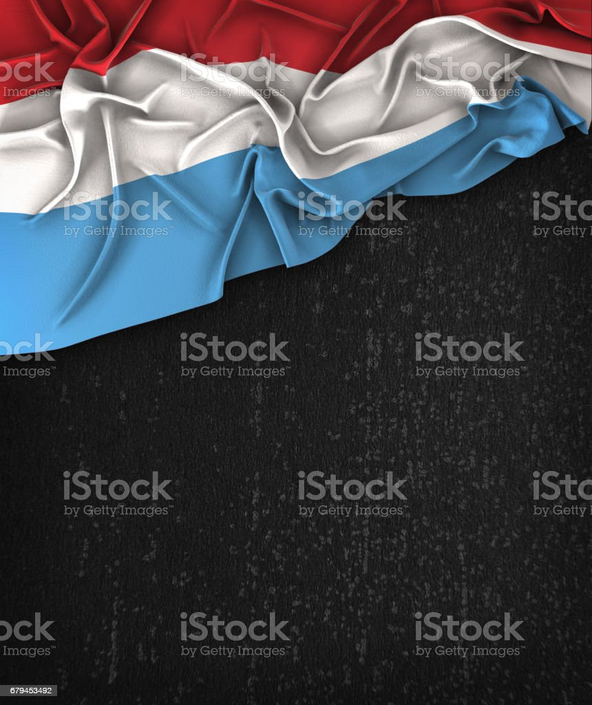 Luxembourg Flag Vintage on a Grunge Black Chalkboard With Space For Text stock photo