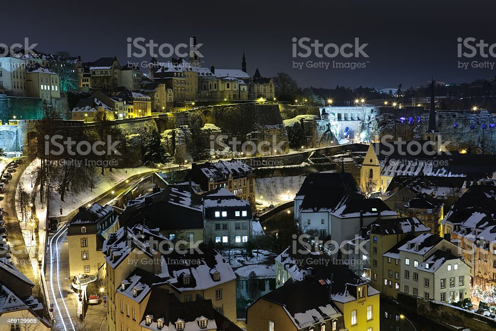 Luxembourg old city under snow at night stock photo