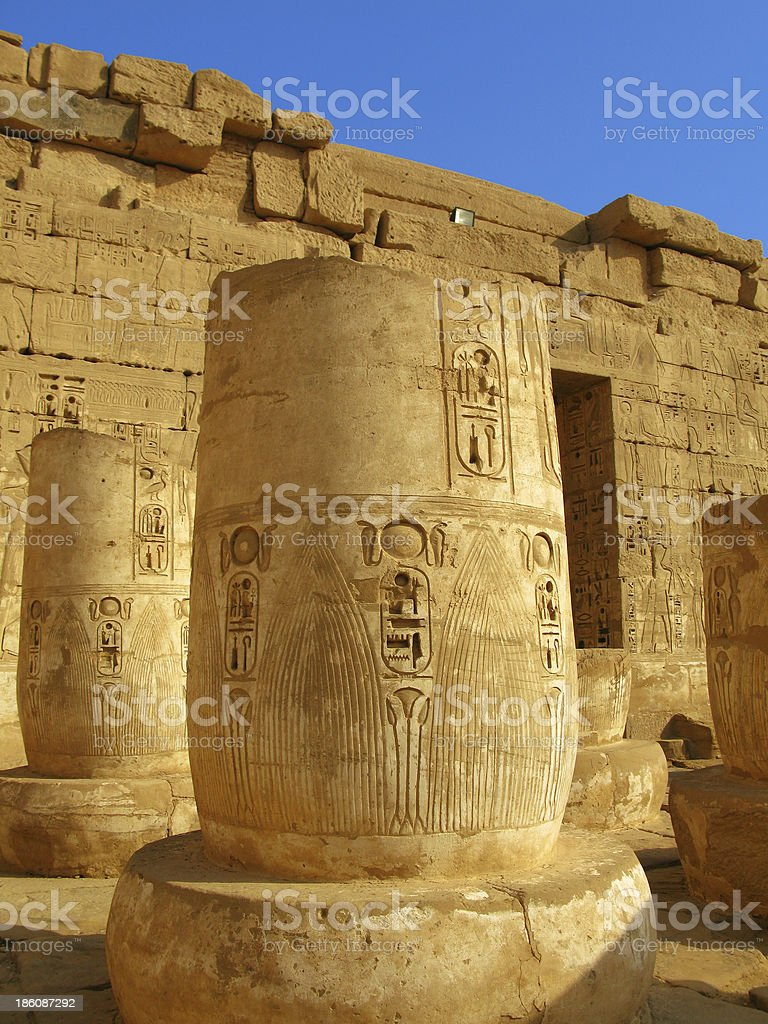 Luxor: Columns with bass-reliefs at the temple of Medinet Habu stock photo