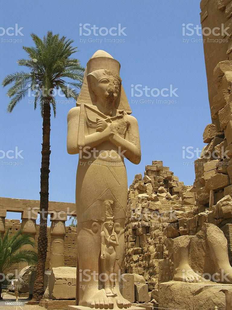 Luxor: giant statue of Pharaoh Ramses II, Amun-Ra Temple, Karnak royalty-free stock photo