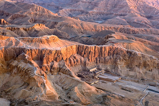 Luxor West Bank above Egypt. Aerial view over the West Bank of Luxor. Deir el-Bahari - the Mortuary Temple of Hatshepsut and fragment of the Valley of the Kings valley of the kings stock pictures, royalty-free photos & images