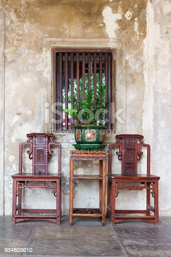 istock Luxuary vintage retro chairs and table with green plants and chinese style flower pot at LHONG 1919 in Bangkok, Thailand. 934803610