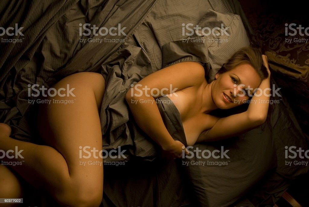 Luxuriating in Bed royalty-free stock photo