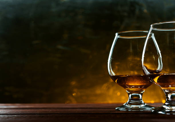 luxurious and expensive French brandy luxurious and expensive French brandy in a glass brandy stock pictures, royalty-free photos & images