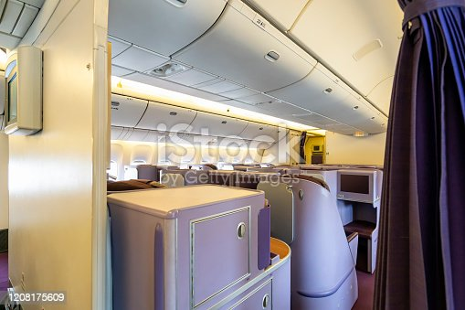 istock Luxurious and modern empty Interior in the airplane or passenger plane while parking view from rear 1208175609
