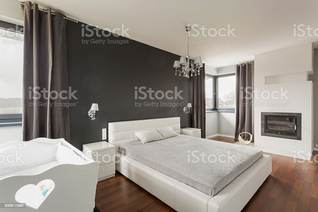 Luxurious and spacious master bedroom stock photo