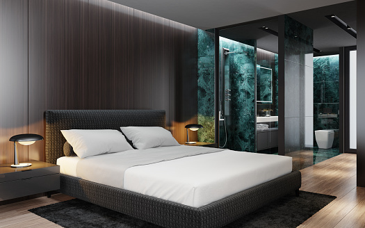 Master bedroom interior with modern matte black walk in wardrobe and shower with large marble green tiles. Modern king size bed with black gloss side tables.  Ceiling with down lighters. Light flooring. 3d rendering.
