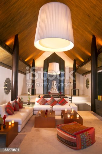 Luxurious indoor dining room of a tropical villa (studio shot).