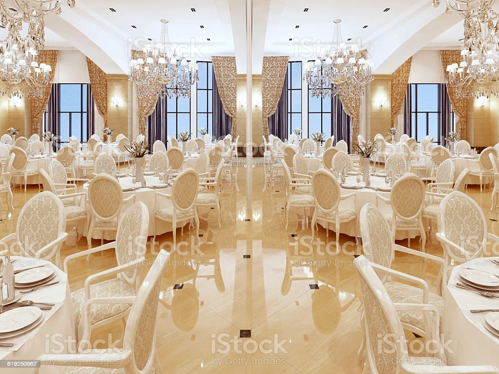 Luxurious ballroom, with white tables and large Windows. stock photo