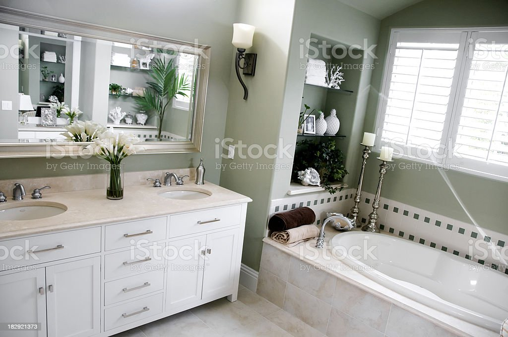 luxurious bathroom in green and white royalty-free stock photo
