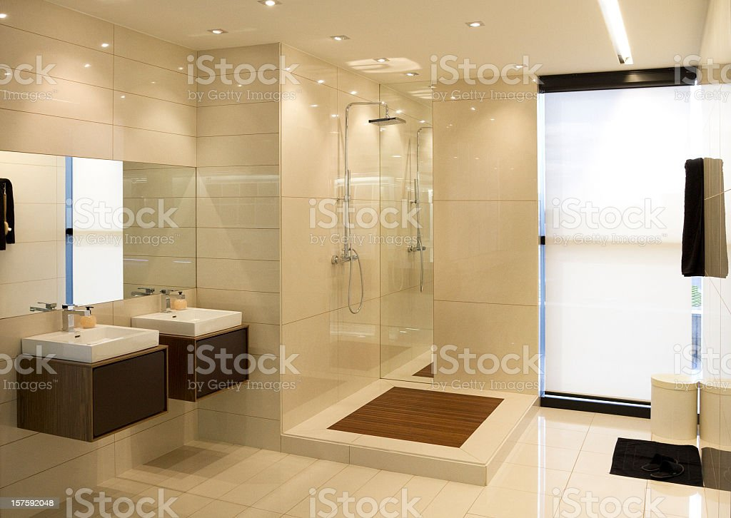 Luxurious bathroom with natural lighting from windows royalty-free stock photo