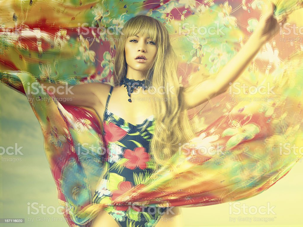 Luxurious blonde in color dress stock photo