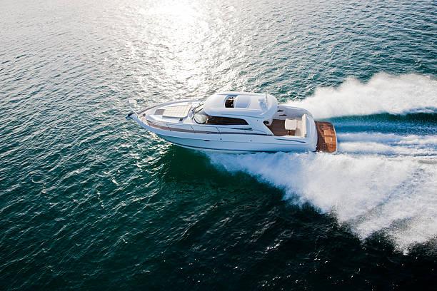 Luxurious boat racing through the ocean stock photo