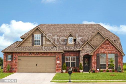 istock Luxurious brick home in expensive neighborhood 146892954