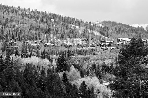 Park City, Utah USA - October 8, 2018 : Evening shot of the luxurious condominiums and ski resorts in Park City Utah after an early Autumn snow storm. Park City was a small mining town in 1800's . Now it is one of the best ski resort town in Utah. Also known for the Sundance Film Festival in every January.