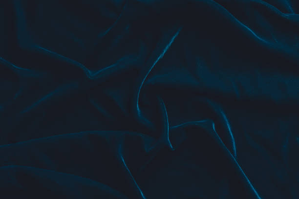 luxurious dark blue velvet fabric background - velvet stock pictures, royalty-free photos & images