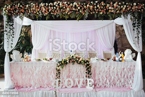istock luxurious decorated table in the main hall wedding 645019594
