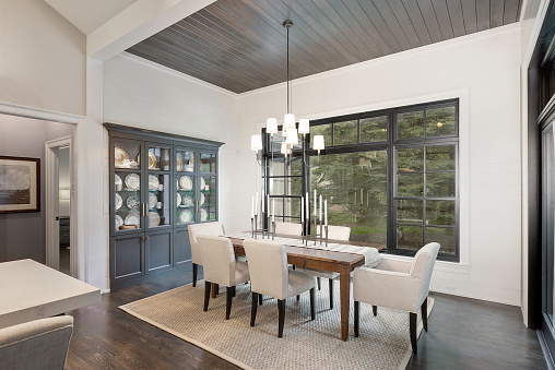 Wonderful built in china cabinet and wood panel ceiling add elegance
