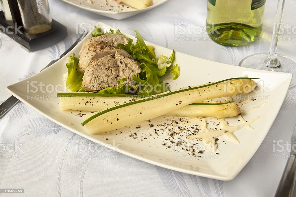 Luxurious dinner - pork sirloin with asparagus and wine royalty-free stock photo