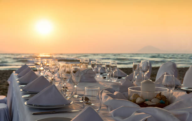 Luxurious dinner table setup on the beach picture id898177184?b=1&k=6&m=898177184&s=612x612&w=0&h=sluq23f5ah8ba9uivpyr9lzqsnrwjcrfhkfm7pjf1sw=