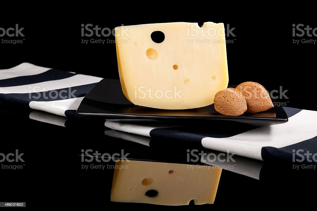Luxurious emmental cheese still life. stock photo