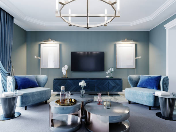 Luxurious fashionable living room in blue and light blue colors classic style. Upholstered blue furniture, armchair, sofa, wardrobe, coffee table.