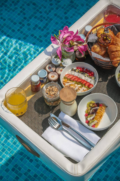 Luxurious Floating Breakfast tray in Swimming Pool stock photo