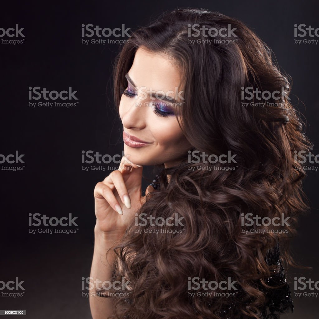 luxurious hair. Portrait of a young attractive woman with gorgeous curly hair. Attractive brunette - Royalty-free Adult Stock Photo