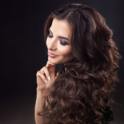 Luxurious Hair Portrait Of A Young Attractive Woman With Gorgeous Curly Hair Attractive Brunette Stock Photo - Download Image Now