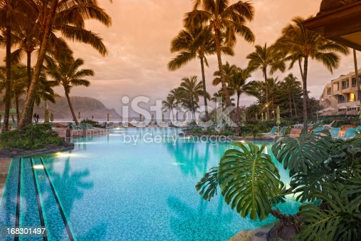 Luxurious Hawaiian 5 star resort with pool view toward ocean and mountains.