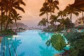 Luxurious Hawaiian 5 star resort with pool view toward ocean and mountains.